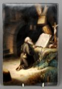 A 19th century KPM painted porcelain plaque Depicting a kneeling praying monk before religious