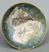 A 19th century cloisonne charger Decorated with vignettes of cranes and dragons amongst floral
