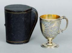 A Victorian silver gilt Christening mug, hallmarked London 1869, maker's mark of TS The main body