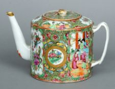 An 18th century Cantonese famille rose teapot With double strap handle and various vignettes of