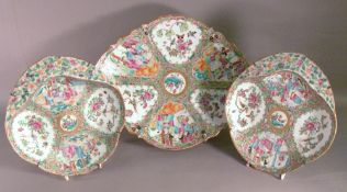 A 19th century Cantonese famille rose tazza Of lobed oval form, standing on a low spreading base,