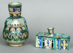 An unusual 18th/19th century Isnik pottery desk stand The shaped rectangular lid with a candle