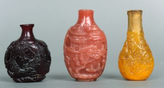 Three various Chinese snuff bottles Each decorated with figures, animals and dragons.  The largest