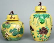 Two late 19th century Chinese ginger jars Each mustard yellow ground decorated in relief with