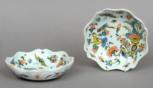 A pair of mid 18th century Rouen polychrome decorated faience lobed dishes Each decorated with