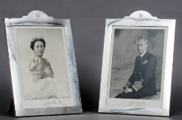 A pair of George VI silver photograph frames, hallmarked Birmingham 1946, maker's mark of Henry