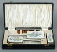 A cased George VI enamel decorated silver dressing table set, hallmarked London 1947, maker's mark