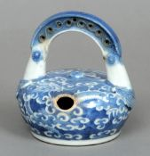 A late Ming Chinese porcelain blue and white lime pot Decorated with a fierce dragon amongst clouds.