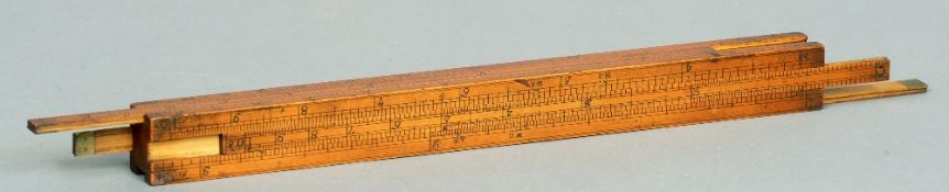 A Victorian boxwood segmental slide rule 30 cms long.   CONDITION REPORTS:  Some scuffing,
