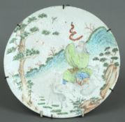 An 18th/19th century Chinese porcelain plaque The circular panel painted with a figure and goats