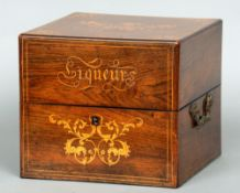 A 19th century French rosewood cased liqueur set The marquetry inlaid top above twin cast gilt metal