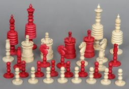 A 19th century carved and stained bone chess set Housed in a mahogany box with a sliding lid. The