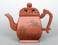 A very fine 18th century Yhsing teapot and reticulated cover Decorated with landscape views to