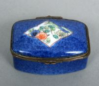 A 19th century porcelain patch box The main body with a blue ground, the hinged domed rectangular