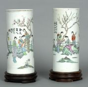 A pair of 19th century Chinese porcelain sleeve vases Each cylindrical body decorated with figures