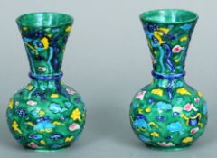 A pair of late 19th century Oriental green ground vases Each decorated with various precious objects