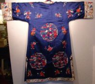 An early 20th century Chinese silk needlework jacket Decorated with floral sprays and a landscape