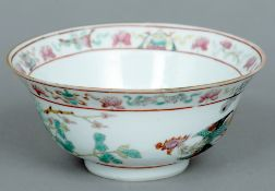 A 19th century Chinese bowl Decorated with a peacock amongst foliage, the underside with red painted
