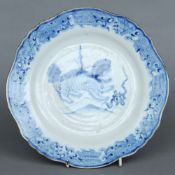 A 19th century blue and white porcelain plate Centrally decorated with a dog-of-fo.  26 cms