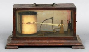 A late 19th/early 20th century barograph Typically formed in an oak case, the interior with