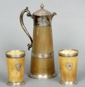 A Victorian silver mounted horn claret jug and two matching silver mounted horn beakers,