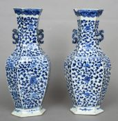 A pair of Chinese porcelain baluster vases Each of hexagonal section with applied twin handles and