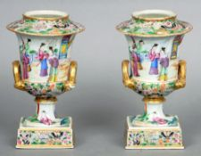 A pair of 19th century Canton campana form urns Each decorated with various figures with gilt