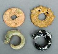 A carved jade disk Decorated with calligraphy; together with three dragon form pendants.  The former