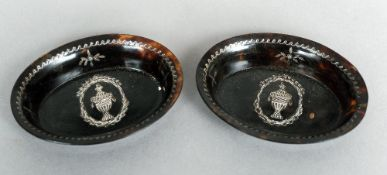 A pair of 19th century unmarked silver inlaid tortoiseshell dishes Each of oval form with central