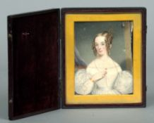 A 19th century miniature on ivory Depicting a young lady wearing a white dress with ringlets in