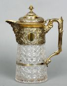 A Victorian silver gilt mounted cut glass claret jug, hallmarked London 1888, maker's mark of CB The