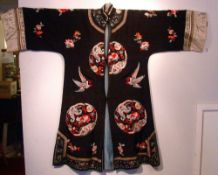 An early 20th century Chinese silk needlework jacket Decorated with exotic birds and floral spray