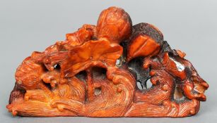 A Chinese carved antler group Modelled as lotus flowers emerging from stylised waves.  11 cms wide.