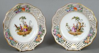 A pair of 19th century Continental porcelain cabinet plates Each rim with pierced foliate decoration