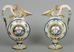 A pair of 19th century Continental faience ewers Each with a scrolling mermaid form handle above the