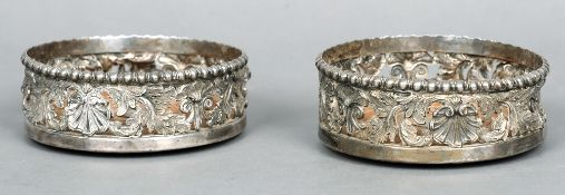 A pair of George IV silver wine coasters, hallmarked Sheffield 1821, maker's mark of IK IW & Co.
