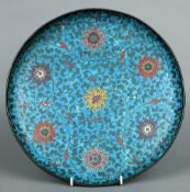 A Chinese cloisonne charger Typically decorated overall with lotus flowers and scrolling vines, four