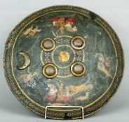 An 18th/19th century Persian leather shield Painted with figures on a tiger hunt centred with a