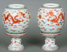 A pair of 19th century Chinese porcelain night lights Each decorated with five clawed dragons