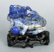 A Chinese lapis dog-of-Fo Typically modelled.  14 cms wide.   CONDITION REPORTS:  Some slight