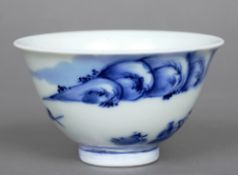 A 19th century Chinese blue and white tea bowl The exterior decorated with a landscape scene and