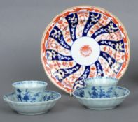 A pair of 19th century Chinese blue and white tea bowls and saucers Decorated with fishermen and