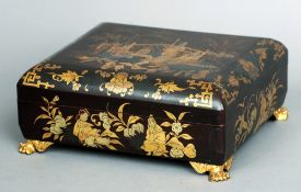 A 19th century Japanese lacquered box The domed removable lid decorated with figures in a garden,