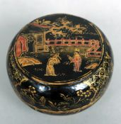 A small 19th century Chinese lacquered box and cover Of circular form, decorated with figures in a