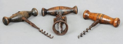 Three various 19th century corkscrews The largest 14.5 cms high.  (3)   CONDITION REPORTS:  Some