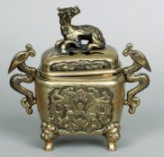 A late 19th century Chinese bronze censor The pierced domed removable top surmounted with a dog-of-