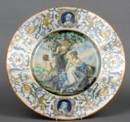 A 19th century Continental faience charger The broad rim with white ground decorated with various