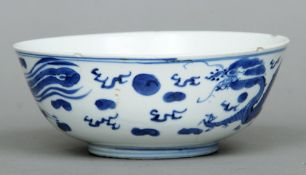 A 19th century Chinese blue and white bowl The exterior decorated with a phoenix and dragon, the