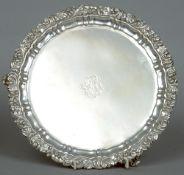 A Georgian silver salver, hallmarked London (marks rubbed), maker's mark of IW The circular body