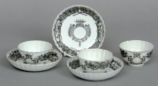 Three 18th century Chinese Export armorial tea bowls and saucers Each piece decorated en grisaille